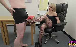Naughty blondie Chessie Kay gives a footjob to a cold man